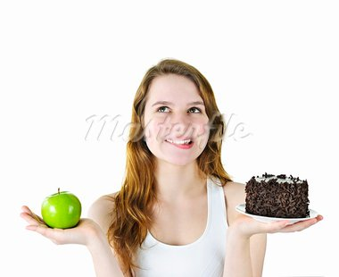 Tempted young woman holding apple and chocolate cake making a choice Stock Photo - Royalty-Free, Artist: Elenathewise                  , Code: 400-05383438