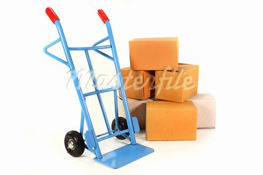 a sack truck and packing boxes on a white background Stock Photo - Royalty-Free, Artist: silencefoto                   , Code: 400-05384943