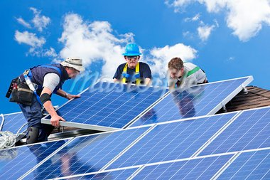 Workers installing alternative energy photovoltaic solar panels on roof Stock Photo - Royalty-Free, Artist: Elenathewise                  , Code: 400-05386117