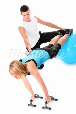 A picture of a young woman working out with her personal trainer over white background Stock Photo - Royalty-Free, Artist: macniak                       , Code: 400-05388749