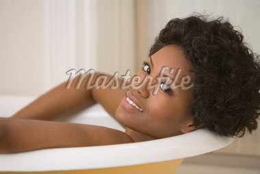 Woman Relaxing in Bathtub Stock Photo - Premium Rights-Managed, Artist: Pierre Arsenault, Code: 700-05389231