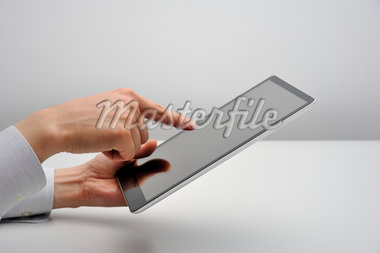 Studio shot of man with digital tablet Stock Photo - Premium Royalty-Freenull, Code: 6106-05393591