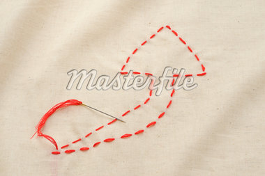 The arrow sewn with a thread Stock Photo - Premium Royalty-Freenull, Code: 6106-05394440
