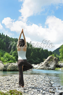 Woman doing yoga in the river Stock Photo - Premium Royalty-Freenull, Code: 6106-05404962