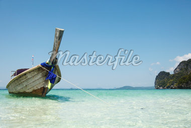 Longtail Boat Moored Stock Photo - Premium Royalty-Freenull, Code: 6106-05447835