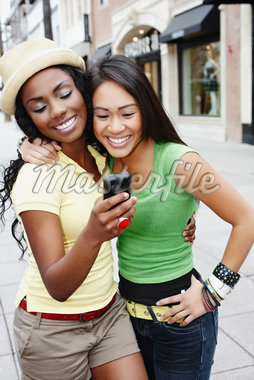 Two Friends with Cell Phone Stock Photo - Premium Rights-Managed, Artist: Peter Griffith, Code: 700-05451001