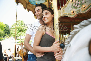 France, Paris, couple riding carousel, man sitting behind woman Stock Photo - Premium Royalty-Freenull, Code: 6106-05455031