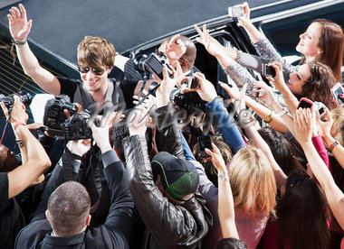 Celebrity waving to paparazzi and fans Stock Photo - Premium Royalty-Freenull, Code: 635-05550031