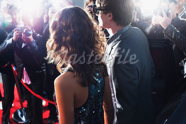 Celebrities posing for paparazzi on red carpet Stock Photo - Premium Royalty-Freenull, Code: 635-05550035
