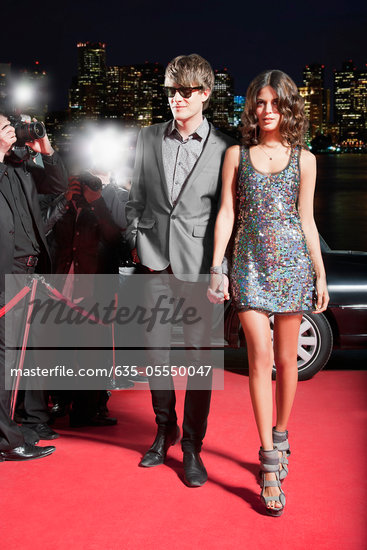 Celebrity walking on red carpet Stock Photo - Premium Royalty-Freenull, Code: 635-05550047
