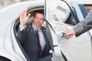 Politician emerging from limo Stock Photo - Premium Royalty-Freenull, Code: 635-05550053