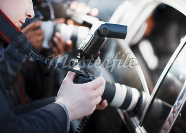 Paparazzi holding camera lens to car window Stock Photo - Premium Royalty-Freenull, Code: 635-05550062