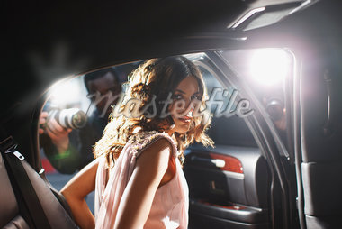 Celebrity emerging from car towards paparazzi Stock Photo - Premium Royalty-Freenull, Code: 635-05550068