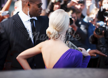Celebrity emerging from car towards paparazzi Stock Photo - Premium Royalty-Freenull, Code: 635-05550079