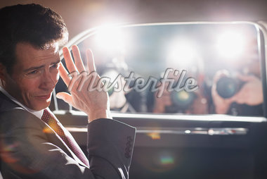Politician shielding himself from paparazzi Stock Photo - Premium Royalty-Freenull, Code: 635-05550085