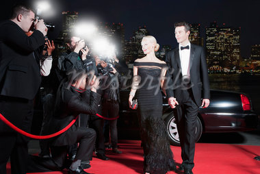 Celebrities posing for paparazzi on red carpet Stock Photo - Premium Royalty-Freenull, Code: 635-05550088