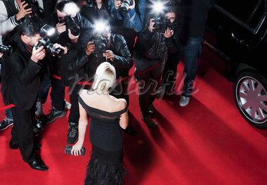 Celebrity posing for paparazzi on red carpet Stock Photo - Premium Royalty-Freenull, Code: 635-05550100