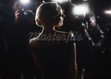Celebrity posing for paparazzi Stock Photo - Premium Royalty-Freenull, Code: 635-05550114