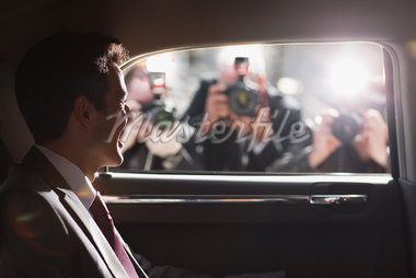 Politician smiling for paparazzi in backseat of car Stock Photo - Premium Royalty-Freenull, Code: 635-05550125