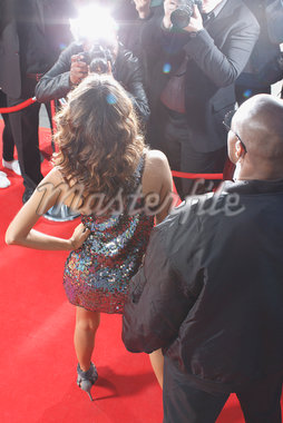 Celebrity posing for paparazzi on red carpet Stock Photo - Premium Royalty-Freenull, Code: 635-05550129