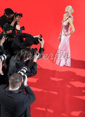 Celebrity posing for paparazzi on red carpet Stock Photo - Premium Royalty-Freenull, Code: 635-05550152