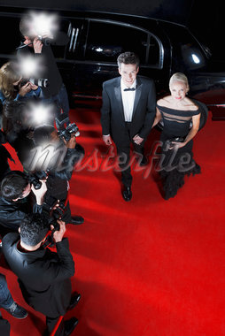 Celebrities walking on red carpet Stock Photo - Premium Royalty-Freenull, Code: 635-05550164