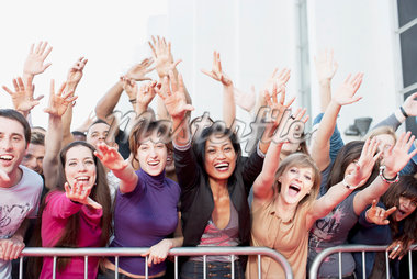 Fans reaching out over barrier Stock Photo - Premium Royalty-Freenull, Code: 635-05550172