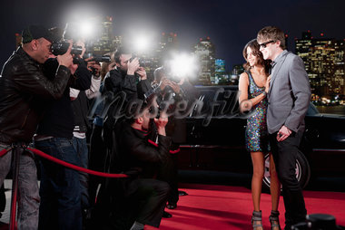 Celebrities posing for paparazzi on red carpet Stock Photo - Premium Royalty-Freenull, Code: 635-05550182