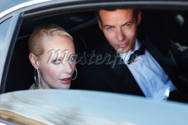 Celebrities sitting in backseat of car Stock Photo - Premium Royalty-Freenull, Code: 635-05550184