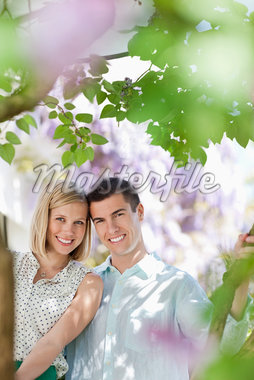Couple sitting together outdoors Stock Photo - Premium Royalty-Freenull, Code: 635-05550212