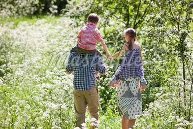 Parents carrying children on their shoulders outdoors Stock Photo - Premium Royalty-Freenull, Code: 635-05550258