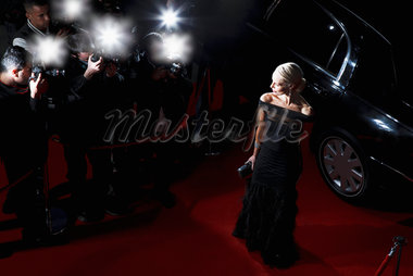 Celebrity posing for paparazzi on red carpet Stock Photo - Premium Royalty-Freenull, Code: 635-05550295