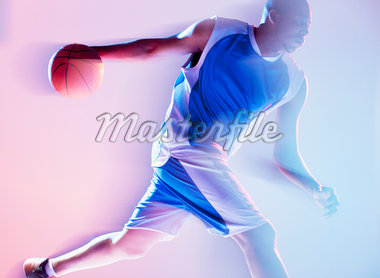 Blurred view of basketball player dribbling Stock Photo - Premium Royalty-Freenull, Code: 635-05550516