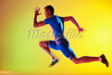 Blurred view of athlete running Stock Photo - Premium Royalty-Freenull, Code: 635-05550542