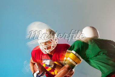 Blurred view of football players with ball Stock Photo - Premium Royalty-Freenull, Code: 635-05550546