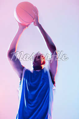 Basketball player holding ball Stock Photo - Premium Royalty-Freenull, Code: 635-05550554