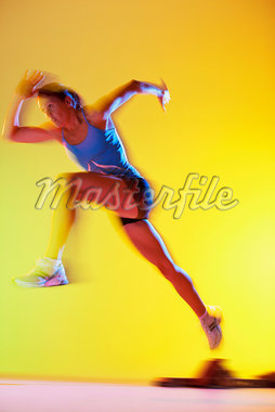 Blurred view of athlete running Stock Photo - Premium Royalty-Freenull, Code: 635-05550558