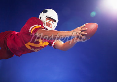Football player lunging for ball Stock Photo - Premium Royalty-Freenull, Code: 635-05550560