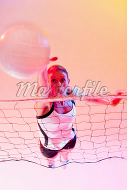 Volleyball player spiking ball over net Stock Photo - Premium Royalty-Freenull, Code: 635-05550563