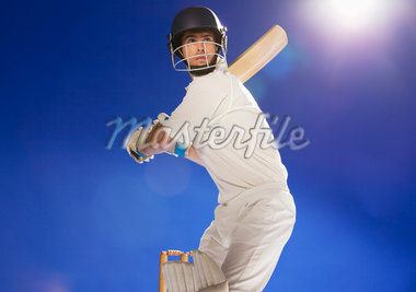 Cricket player holding bat Stock Photo - Premium Royalty-Freenull, Code: 635-05550592