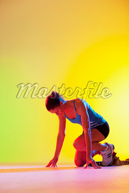 Runner crouched in starting block Stock Photo - Premium Royalty-Freenull, Code: 635-05550614