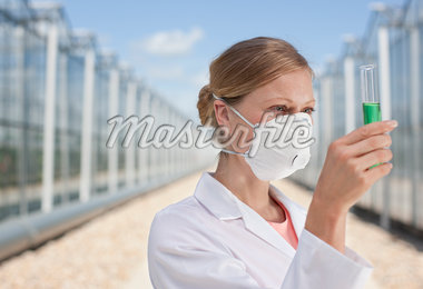 Scientist examining contents of test tube outdoors Stock Photo - Premium Royalty-Freenull, Code: 635-05550708