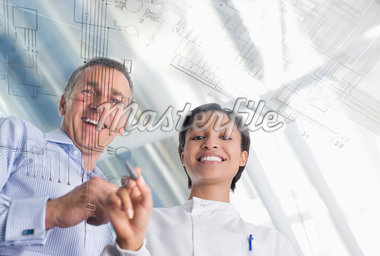 Scientists using touch screen in lab Stock Photo - Premium Royalty-Freenull, Code: 635-05550824
