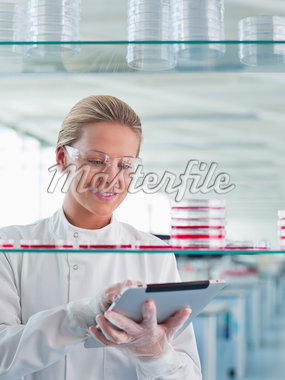 Scientist using tablet computer in lab Stock Photo - Premium Royalty-Freenull, Code: 635-05550850