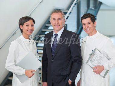 Businessman and scientists smiling together Stock Photo - Premium Royalty-Freenull, Code: 635-05550854