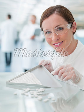 Scientist examining pills in lab Stock Photo - Premium Royalty-Freenull, Code: 635-05550868