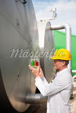Scientist examining test tubes outdoors Stock Photo - Premium Royalty-Freenull, Code: 635-05550882