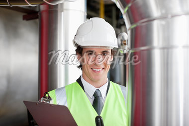 Businessman in safety gear examining pipes Stock Photo - Premium Royalty-Freenull, Code: 635-05550941