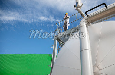 Scientist standing on walkway on tanks Stock Photo - Premium Royalty-Freenull, Code: 635-05550942