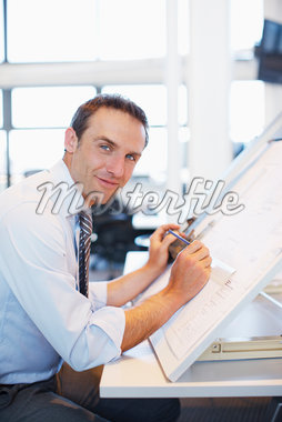 Architect working at desk Stock Photo - Premium Royalty-Freenull, Code: 635-05551046